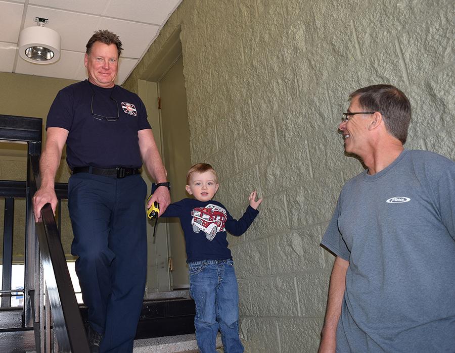 Preschooler with Firefighters