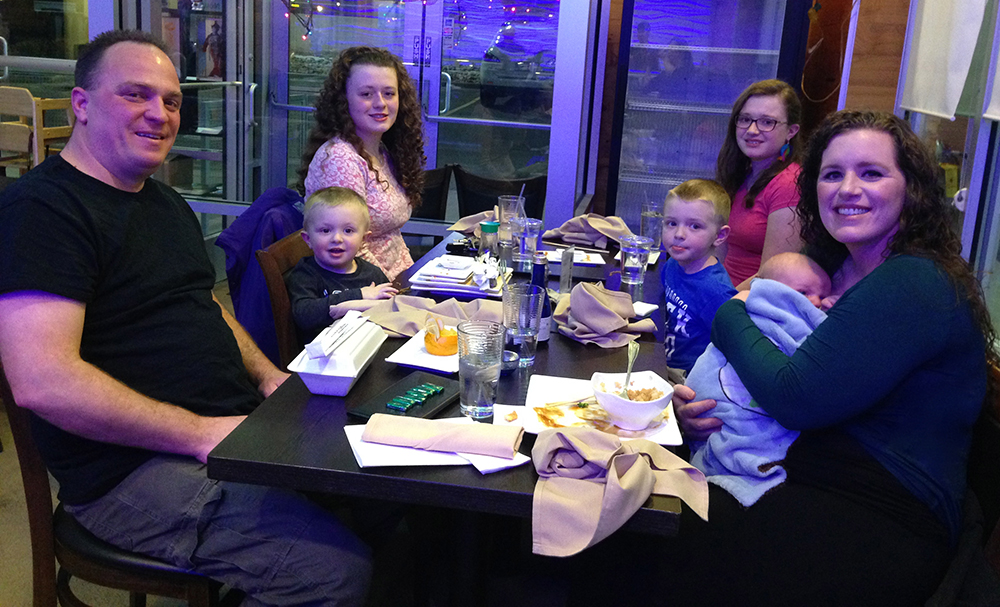 Family of 7 Having Dinner at Sushi Restaurant